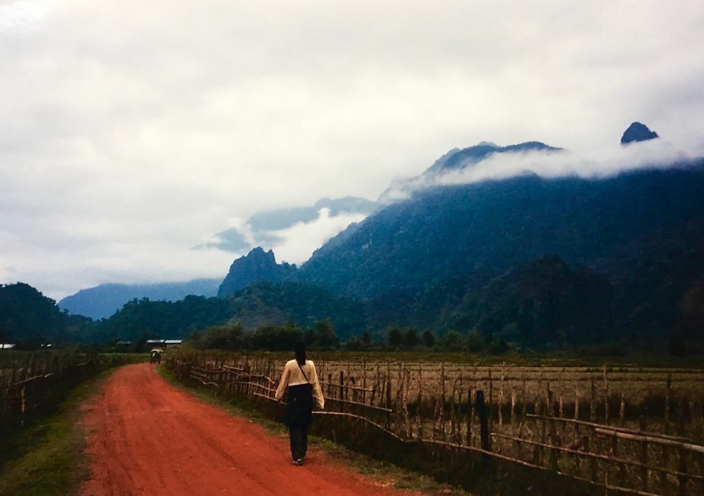 Gabrielle Panepinto Reiser walking on a path on Laos in the year 2000