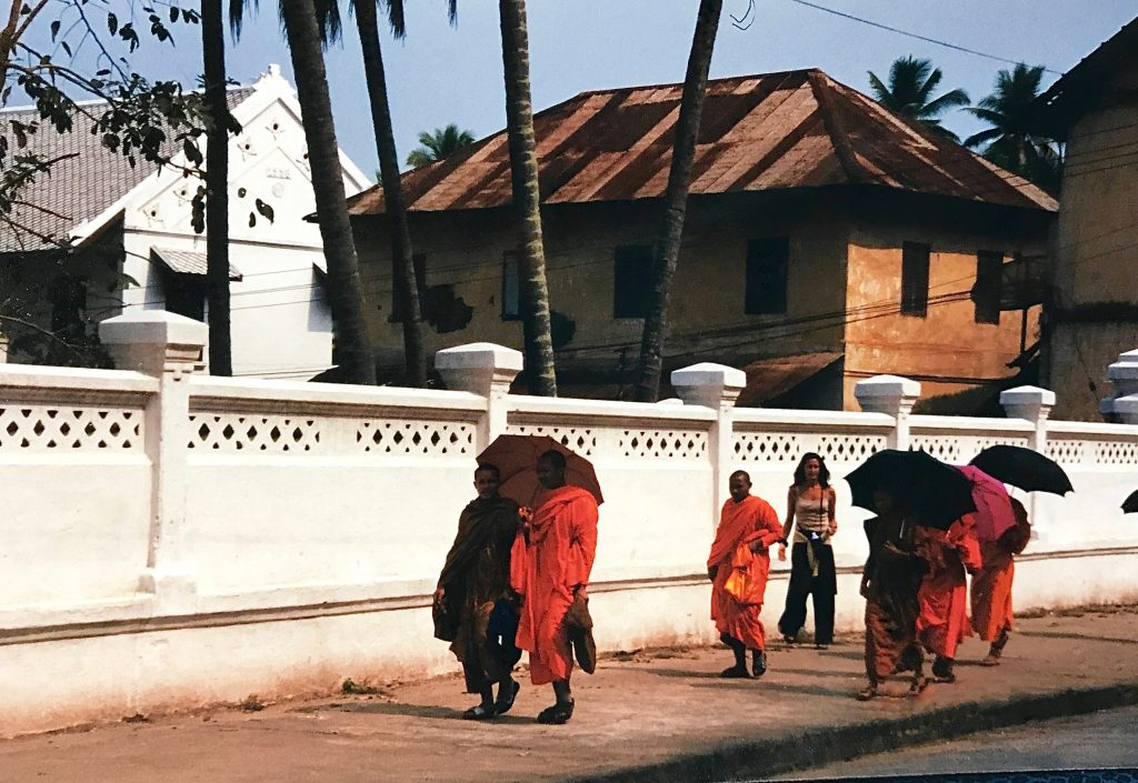Gabrielle Panepinto Reiser walking with Buddhist in Thailand in the year 2000