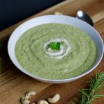 A bowl of dairy-free asparagus soup that is vegan, gluten free, paleo. runcooklaugh.com