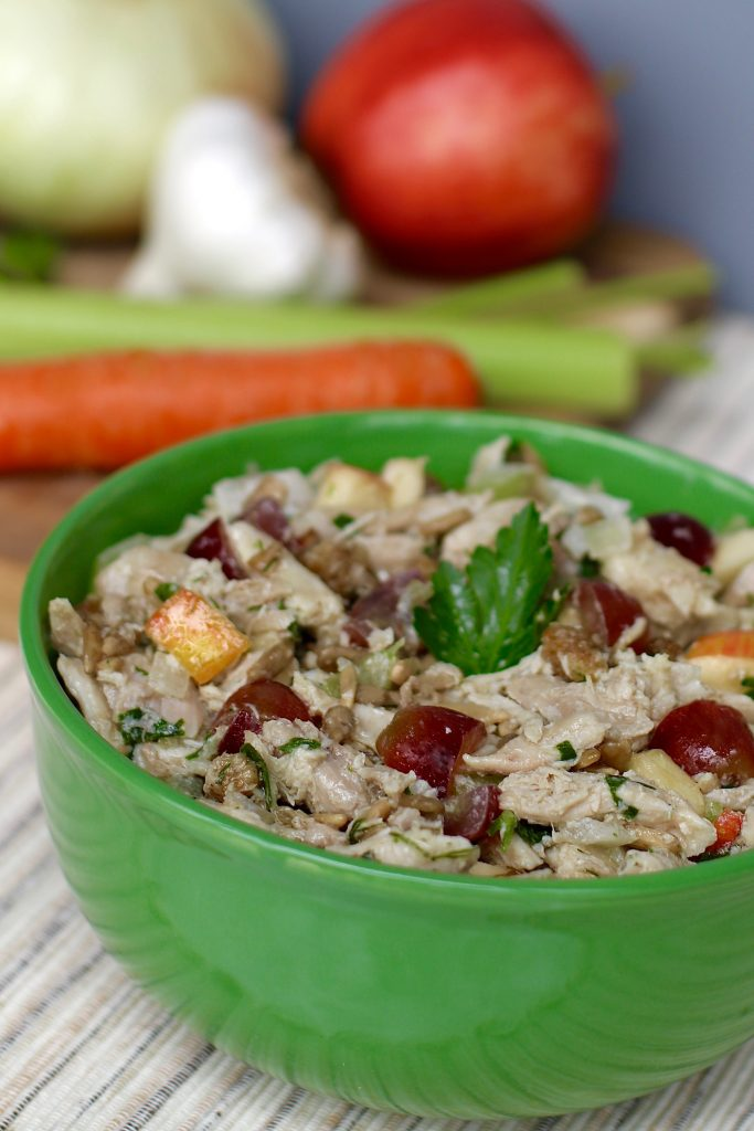 A bowl of healthy chicken salad made with chickpea mayonnaise. runcooklaugh.com
