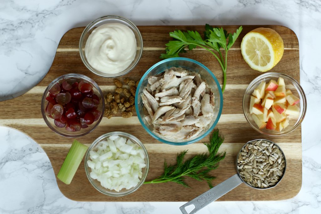 All the ingredients in my chicken salad on a cutting board. runcooklaugh.com
